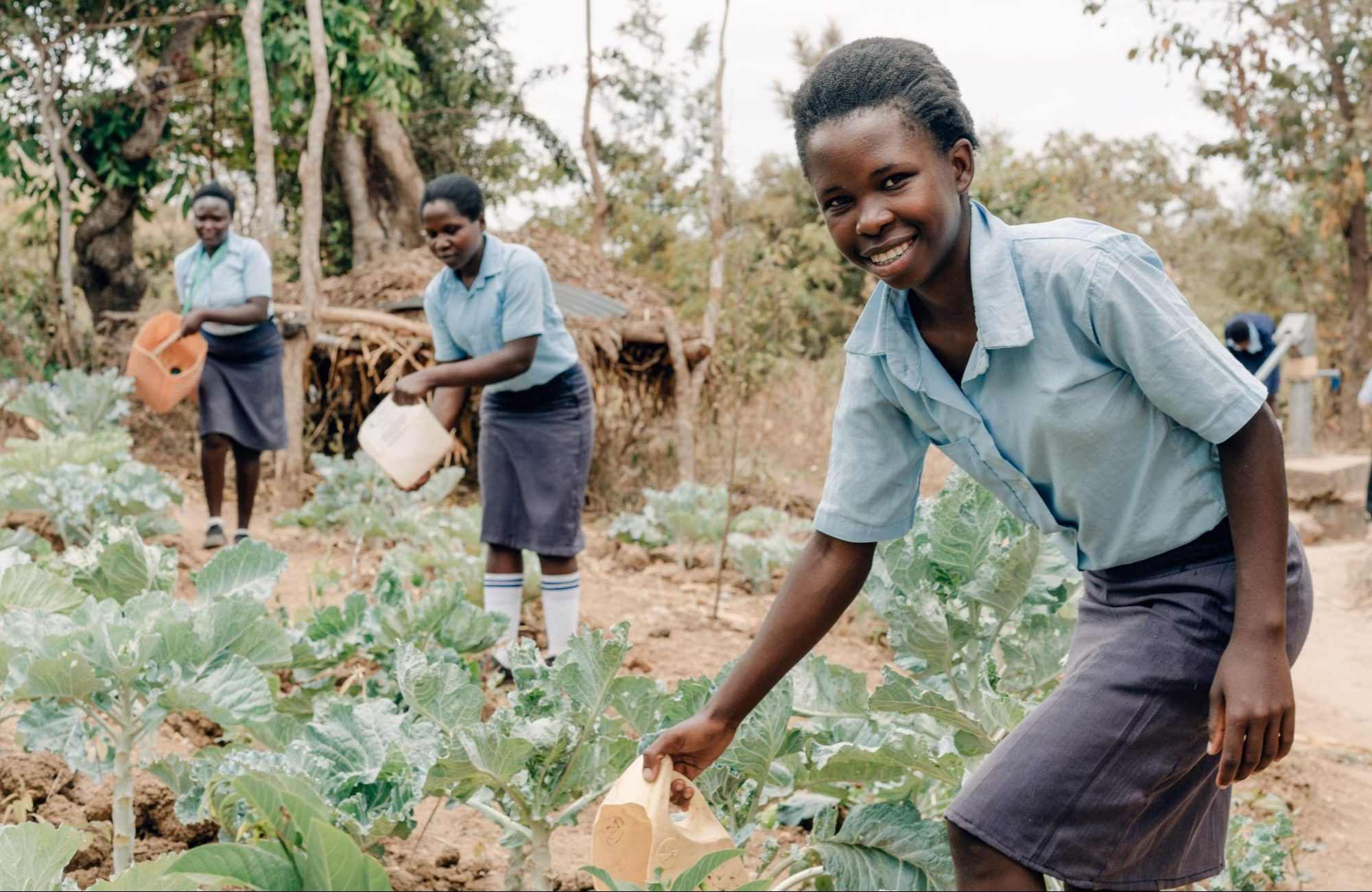 Students from SOH Kitui watering their vegetable garden